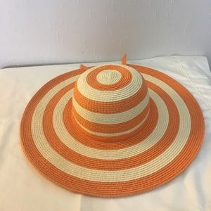 Orange and cream floppy straw beach hat